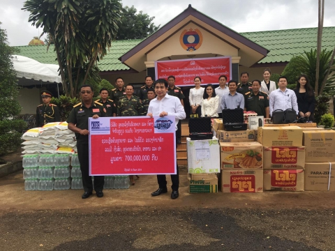 aidc company helping the suffering and the disasters in  champasak with cash  equipment  food and medicine total value 700 000 000 kip